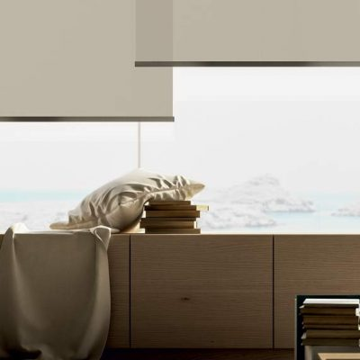 Multiple cream roller shades in luxury home